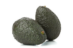 Two whole, uncut ripe avocado fruit Royalty Free Stock Photo