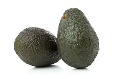 Two whole, uncut ripe avocado fruit Stock Images