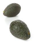 Two whole, uncut ripe avocado fruit Royalty Free Stock Photography