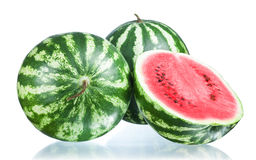 Two Whole watermelon and half  Royalty Free Stock Images