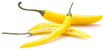 Chilli Pepper. Two whole yellow Chili peppers, one half, isolated on white backgroundn stock images