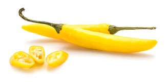 Chilli Pepper. Two whole yellow Chili peppers and three slices isolated on white backgroundn stock photography