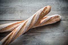 Two wholewheat baguettes on the wooden background Stock Image