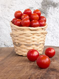 Two wicker baskets stacked with a handful of pachino tomatoes Royalty Free Stock Photography
