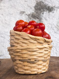 Two wicker baskets stacked with pachino cherry tomatoes Royalty Free Stock Photo