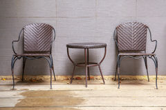 Two wicker chair near wall create a natural feel. Stock Image