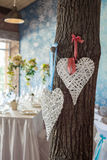 Two wicker hearts hanging on tree. Stock Images