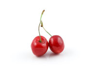 Two wild cherries isolated on white Stock Image