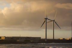 Two wind turbine move at sunset beautiful light, Spain, Fuerteventura island Royalty Free Stock Photos