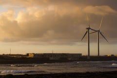 Two wind turbine move at sunset beautiful light, Spain, Fuerteventura island Royalty Free Stock Images