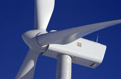 Two Wind Turbines. Close-up of Wind Turbines against blue sky Royalty Free Stock Photography