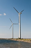 Two wind turbines. By the sea Royalty Free Stock Image