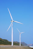 Two wind turbines Stock Images