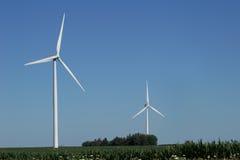 Two Large Wind Turbines. Wind Turbines in a corn field Royalty Free Stock Photo