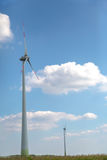 Two wind turbines on a cornfield Stock Image