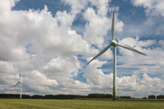 Two wind turbines in a Dutch landscape Royalty Free Stock Photo