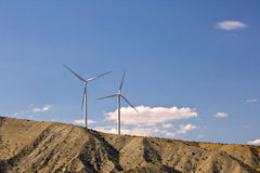 Two Wind Turbines on Hillside Stock Photos