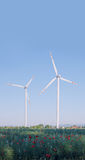 Two wind turbines in a rural landscape Stock Images