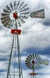 Two wind wheels or wind pumps up close. A vertical view of two wind wheels or wind pumps up close stock images
