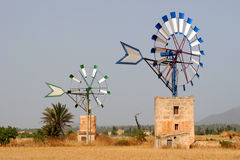 Two windmills. Near the famous mill-tour at campos, mallorca Royalty Free Stock Image