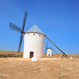 Two windmills. Castile La Mancha, Spain. Two windmills near Alcazar de San Juan, Castile - La Mancha. Castile - La Mancha region, Spain, is famous due to its Stock Images