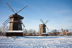 Two windmills and church Stock Photos