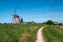 Two windmills on a along the polder near Maasland, the Neth Royalty Free Stock Images