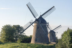 Two windmills in a field Royalty Free Stock Photo