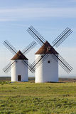 Two windmills front view Royalty Free Stock Photos