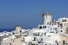 Two windmills in oia Royalty Free Stock Images
