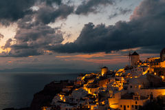 Two windmills of Oia after the sunset, Oia, Santorini, Greece royalty free stock photo