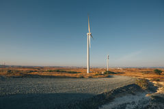Two windmills by roadside in a rural landscape in Cyprus Stock Photography