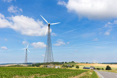 Two windmills in rural area with blue sky Stock Images