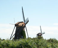 Two windmills sunny sumer day Royalty Free Stock Image