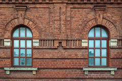 Two window on a brown wall. Royalty Free Stock Images