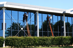 Two window cleaners at work royalty free stock photo