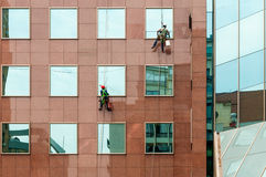 Two Window Washers and offices building, square frame Stock Image