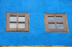 Two window wooden. Twowindow wooden on blue wall Royalty Free Stock Photos