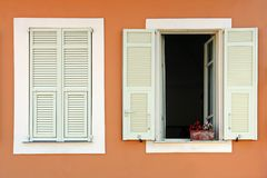 Two Windows. Wall with two windows one opened and one closed royalty free stock images