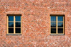 Two windows. In a brick wall Stock Photo