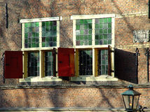 Two windows. Two similar windows from an old building in Amsterdam Stock Photos