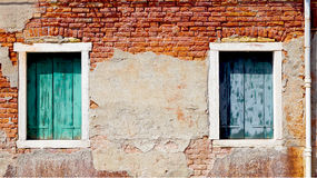 Two windows and ancient decay brick wall Stock Images