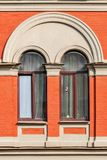 Two windows with arch. Two windows with white arches in the background of wall of red brick. From the window of Saint Petersburg Royalty Free Stock Images