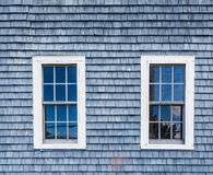 Two Windows in Blue Clapboard Stock Image