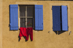 Two windows with blue shutters. France Stock Photography