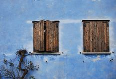 Two Windows in Blue Wall, Topolo Royalty Free Stock Photo