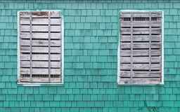 Two windows boarded up Stock Photography