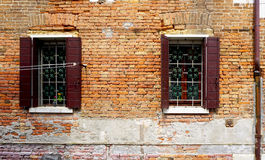 Two windows with brick decay wall building Stock Photo
