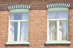 Two windows on a brick facade Royalty Free Stock Photos