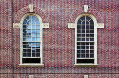 Two windows in brick wall. Two arched windows in brick wall Stock Photography